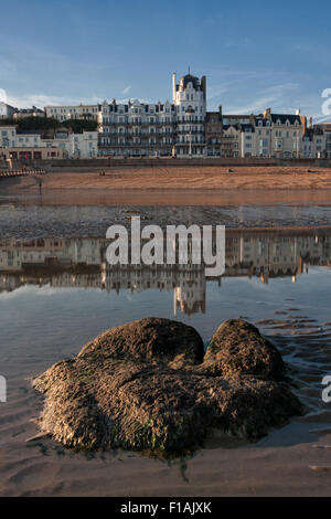 Palace Court, White Rock, Hastings, East Sussex, England reflected in a tidal pool on a warm September evening. - Stock Photo