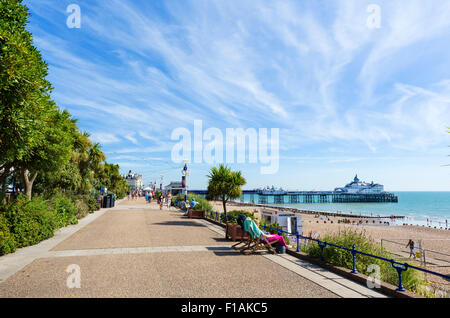 The seafront promenade and pier in Eastbourne, East Sussex England, UK - Stock Photo