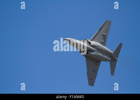 Military jet on training banking right - Stock Photo