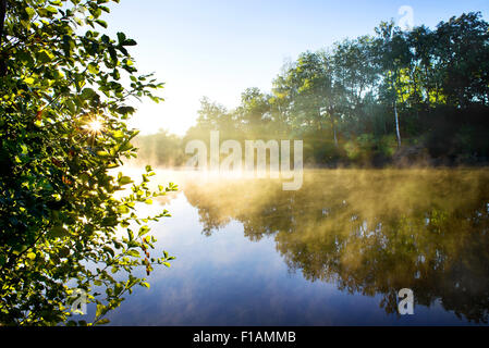 Fog on the morning river in late summer - Stock Photo