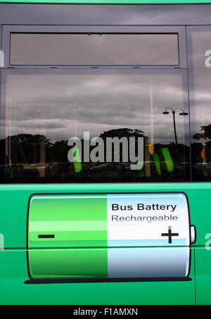 An electric bus operating as a Park and Ride service, pauses for charging in the War Memorial Park in Coventry, - Stock Photo