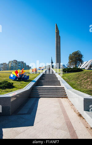 Belarus, Minsk, view to obelisk and statue in the Pieramohi Park - Stock Photo