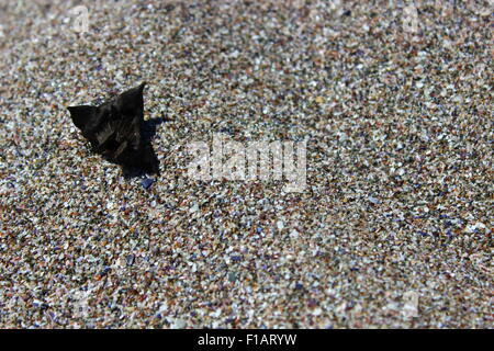 Take the black with a grain of sand - Stock Photo