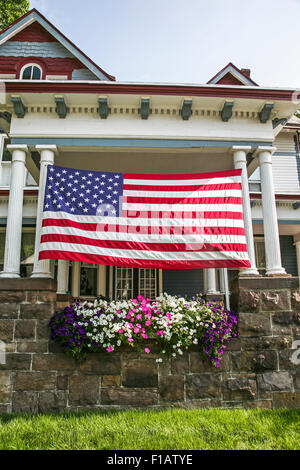 Large American flag on a Victorian house in Hightstown,  New Jersey, USA, US flag - Stock Photo