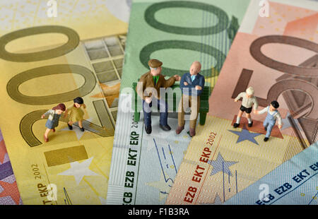 Old people sitting on a bench, with children, euro banknotes, symbol for generations, retirement, pension - Stock Photo