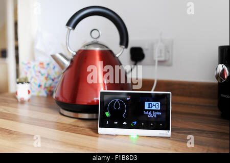 British Gas smart meter showing consumption of electricity and gas used with domestic appliance a kettle in the - Stock Photo