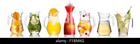 Variety of alcoholic cockatails in glass pitchers - Stock Photo