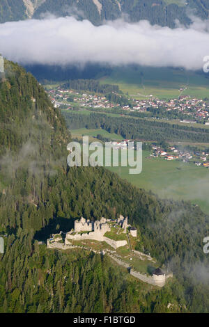 EHRENBERG CASTLE IN MORNING FOG (aerial view). Above the city of Reutte, Tyrol, Austria. - Stock Photo