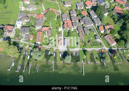 PRIVATE HOMES WITH THEIR PRIVATE DOCKS (aerial view). Fraueninsel, also Frauenchiemsee is an island in Lake Chiemsee, - Stock Photo