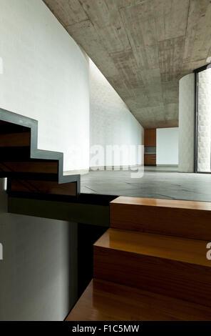interior modern villa, passage, wooden staircase - Stock Photo