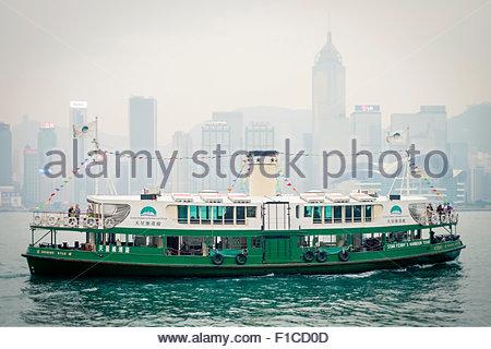 Star Ferry Boat on Victoria Harbor seen from Tsim Sha Tsui, Kowloon, Hong Kong, China - Stock Photo