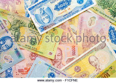 Vietnamese Dong currency, various denominations of paper banknotes, money - Stock Photo