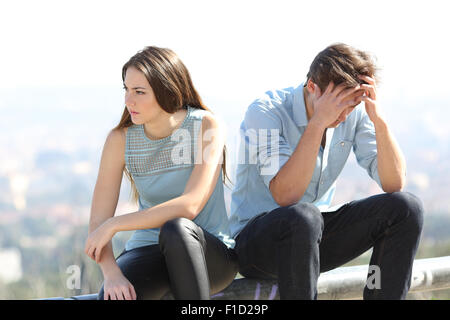 Bad girl arguing with her couple breakup concept with the city in the background - Stock Photo