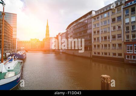 Nikolaifleet in Hamburg with sunlight - Stock Photo