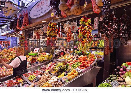 Fruits and vegetables stall at La Boqueria market in Ciutat Vella Barcelona Catalonia Spain Europe - Stock Photo