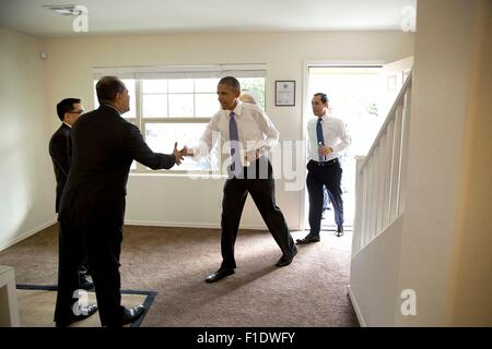 U.S. President Barack Obama and Housing and Urban Development Secretary Julian Castro visit a model home at the - Stock Photo