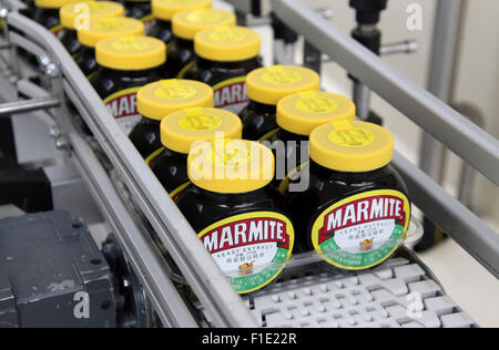 Marmite jars on the production line at the Unilever factory at Burton upon Trent in Staffordshire - Stock Photo