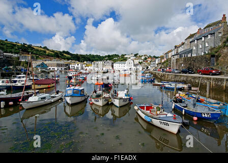 Cornwall coast line and the fishing village of Mevagissey with colourful trawlers in the working harbour. - Stock Photo