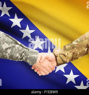 Soldiers shaking hands with flag on background - Bosnia and Herzegovina - Stock Photo