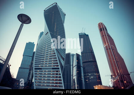 Vintage stylized photo of skyscrapers in Moscow at dusk - Stock Photo