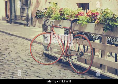Bicycle on old street. Vintage stylized. - Stock Photo