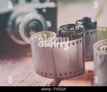 Old photo film rolls, cassette and retro camera on background. Vintage styled. - Stock Photo