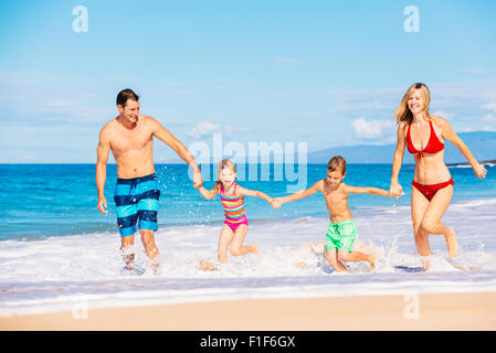 Family vacation. Happy family having fun on beautiful warm sunny beach. Outdoor summer lifestyle. - Stock Photo