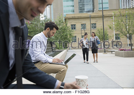 Business people in urban park - Stock Photo