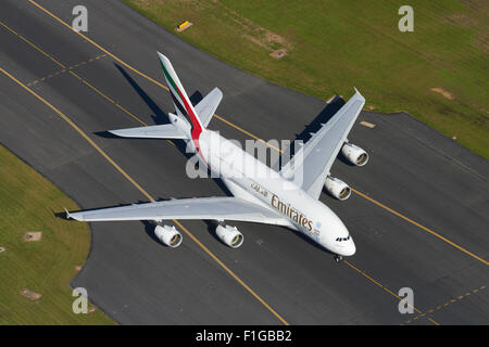 Emirates Airbus A380 at Auckland Airport, North Island, New Zealand - aerial - Stock Photo