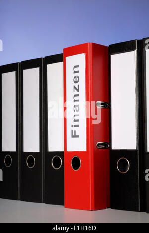 Red file folder labeled Finance - Stock Photo