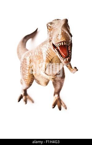 toy plastic replica of a Tyrannosaurus Rex isolated - Stock Photo