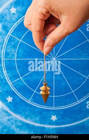 astrology and pendulum - Stock Photo