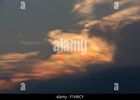 Magical iridescent clouds, Nacreous, clouds or mother of pearl cloud in an evening sky. - Stock Photo