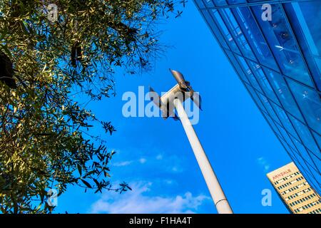 Miniature windmill next to shopping centre, Manchester, UK - Stock Photo