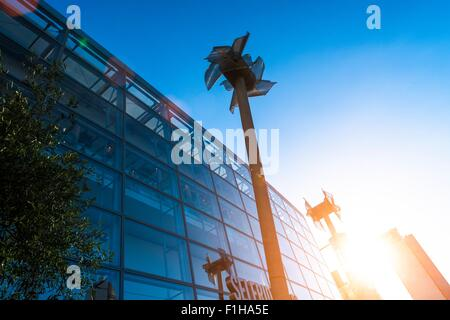 Miniature windmills next to shopping centre, Manchester, UK - Stock Photo