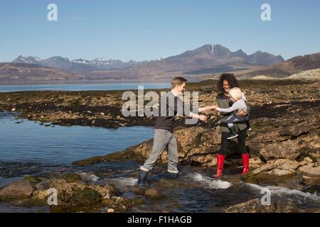 Mother holding son by Loch Eishort, Isle of Skye, Hebrides, Scotland - Stock Photo