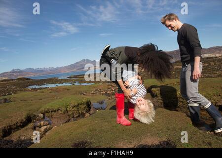 Mother tickling son, Loch Eishort, Isle of Skye, Hebrides, Scotland - Stock Photo