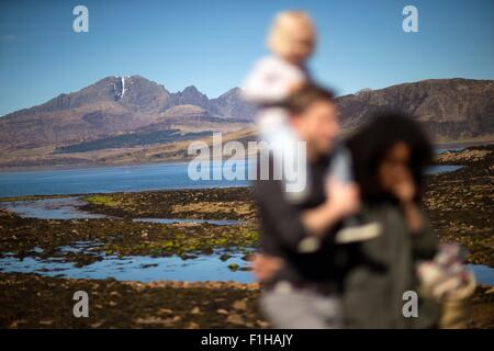 Family at Loch Eishort, Isle of Skye, Hebrides, Scotland - Stock Photo