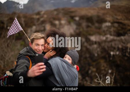Family photographing themselves on hike - Stock Photo