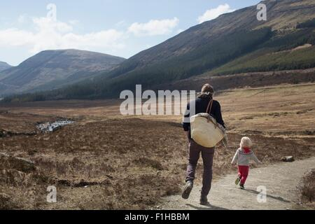 Father and son out hiking, Fairy Pools, Isle of Skye, Hebrides, Scotland - Stock Photo