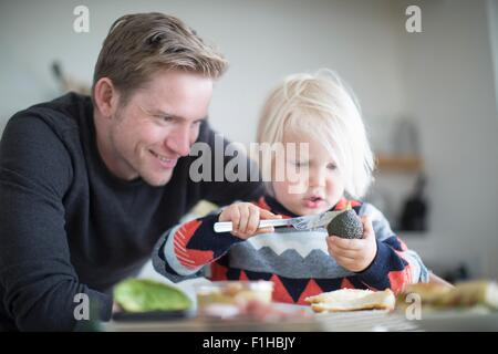 Father andf son preparing food - Stock Photo