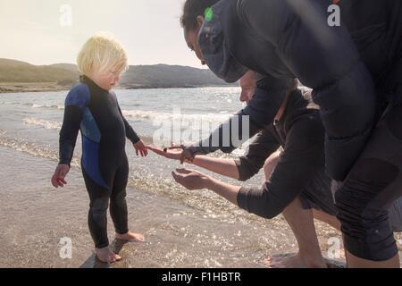 Boy and parents on beach, Loch Eishort, Isle of Skye, Scotland - Stock Photo