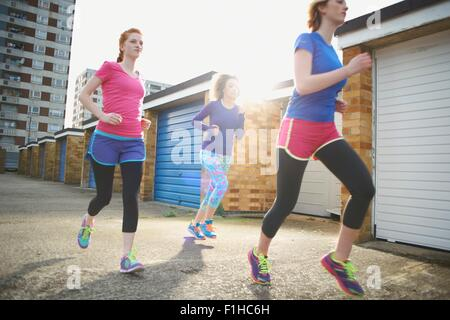 Three women exercising and jogging together - Stock Photo