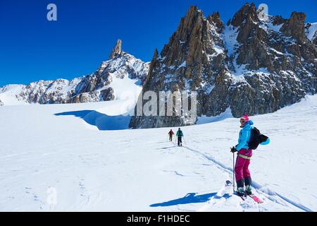 Three skiers on Mont Blanc massif, Graian Alps, France - Stock Photo