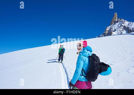 Mature female skier looking out from Mont Blanc massif, Graian Alps, France - Stock Photo