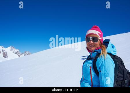 Portrait of mature female skier on Mont Blanc massif, Graian Alps, France - Stock Photo