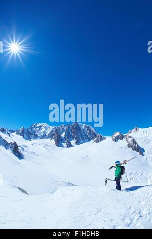 Mature male skier looking out from Mont Blanc massif, Graian Alps, France - Stock Photo
