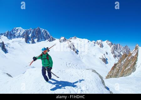 Mature male skier on ridge at Mont Blanc massif, Graian Alps, France - Stock Photo