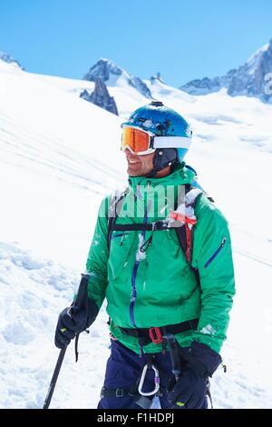 Portrait of mature male skier on Mont Blanc massif, Graian Alps, France - Stock Photo