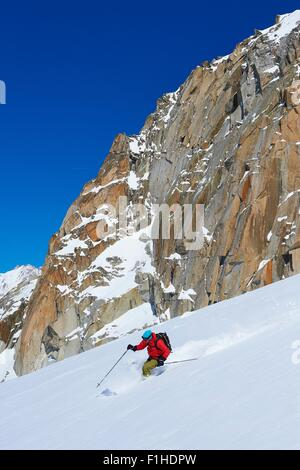 Male skier speeding downhill on Mont Blanc massif, Graian Alps, France - Stock Photo